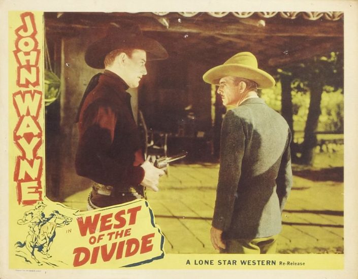 Lobby card of the John Wayne movie West of the Divide