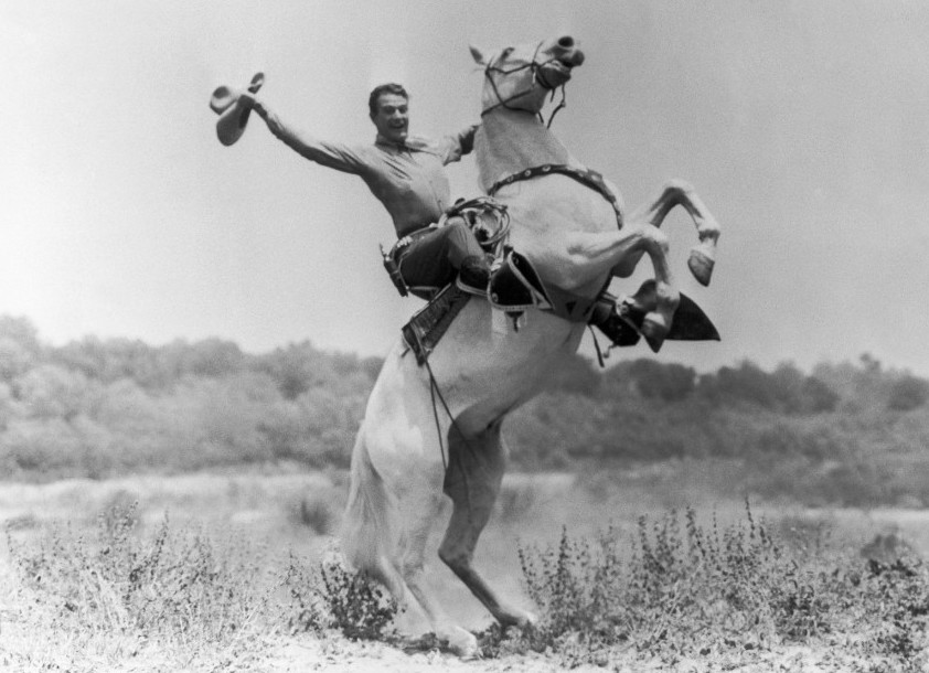 John Wayne on Starlight, his horse