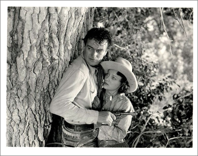 John Wayne and Sheila Manners in the 1935 movie Lawless Range