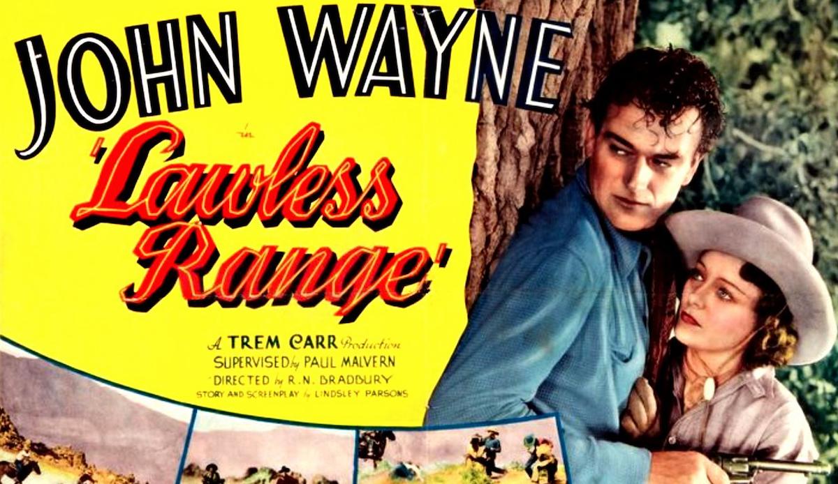 John Wayne in Lawless Range lobby card