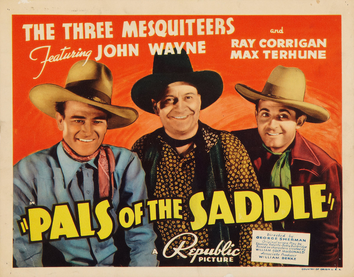 John Wayne in Pals of the Saddle lobby card