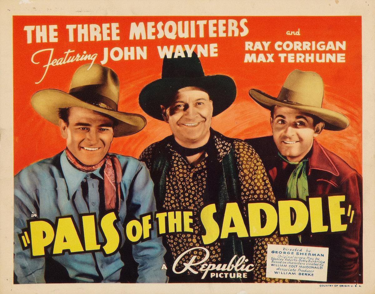 John Wayne in Pals of the Saddle lobby card