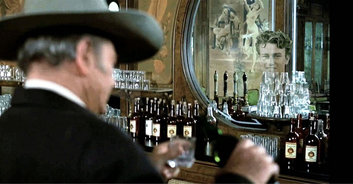 John Wayne in The Shootist drinking at a bar