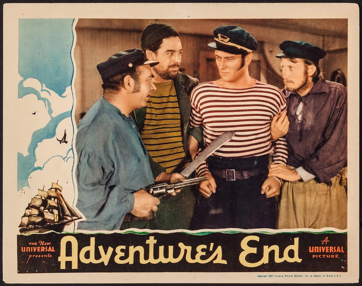 a lobby card showing John Wayne in Adventures End